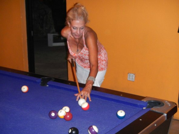 Patricia flailing about at the pool table...