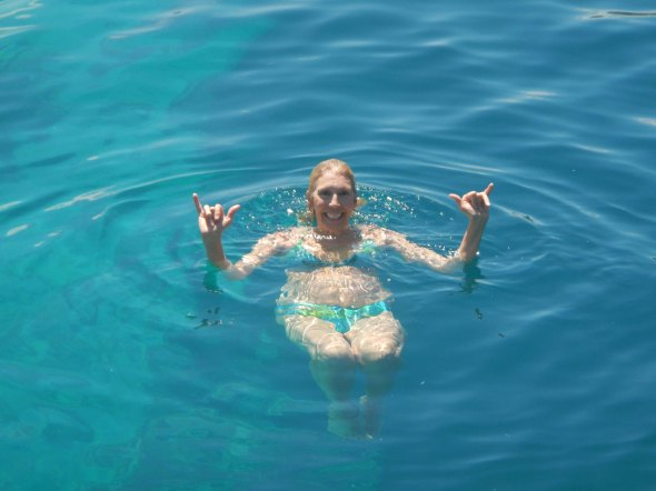 Rhonda swimming after her jump into the big blue hole!