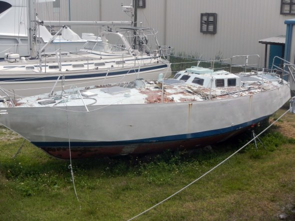 "Steel hull, also in foreclosure.  They ""bury"" the long term ones up to the hull so they won't tip over in hurricanes"