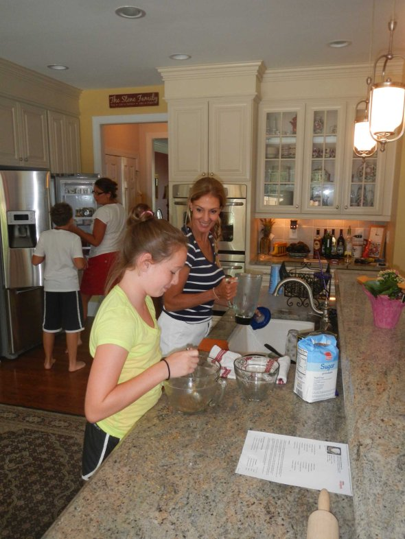 Patricia enjoying a full size kitchen with Julia